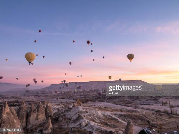 hot air balloons flying in red and rose valley in goreme in cappadocia in turkey - 4k resolution stock pictures, royalty-free photos & images