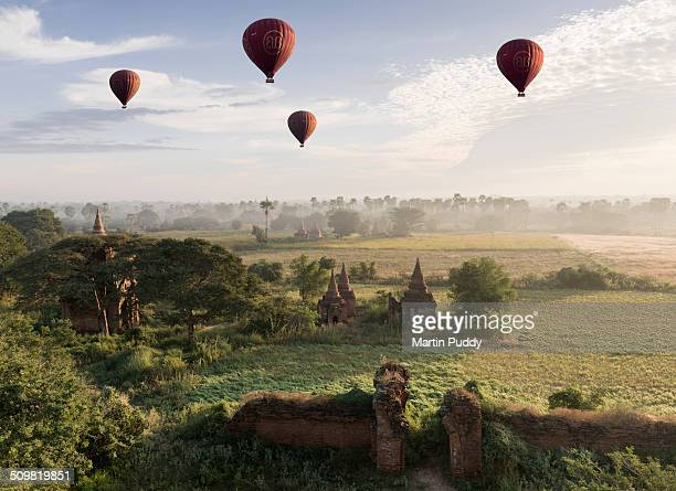 hot air balloons flying over ancient temples