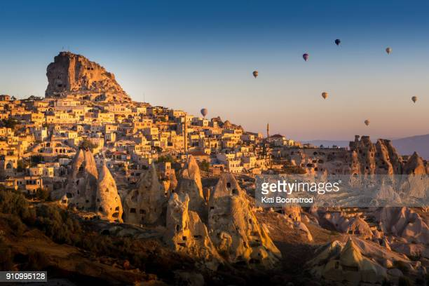 hot air balloons flying over pigeon valley of cappadocia, turkey - cappadocia stock pictures, royalty-free photos & images
