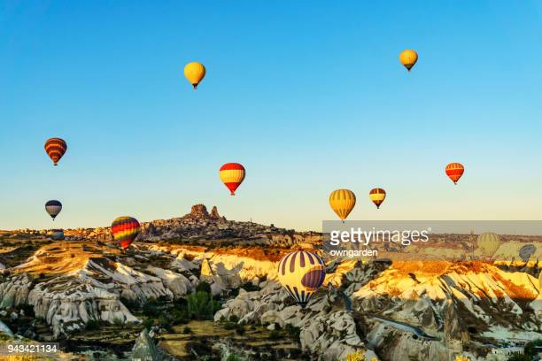 hot air balloons flying over spectacular cappadocia - 21st century stock pictures, royalty-free photos & images