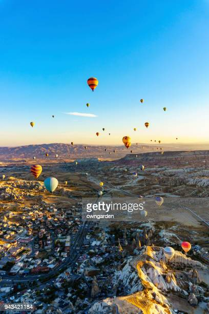 hot air balloons flying over spectacular cappadocia - physical geography stock pictures, royalty-free photos & images