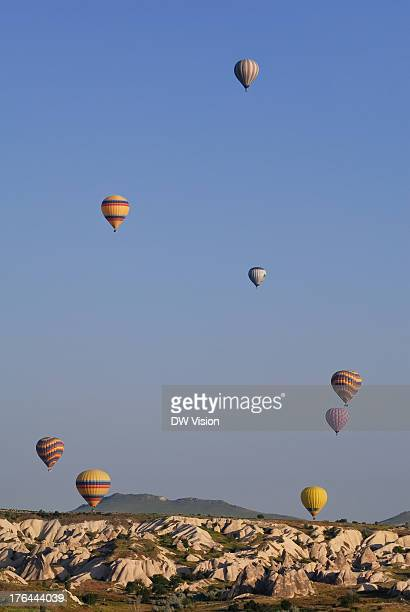 CONTENT] Hot air balloons flying over the characteristic landscape of Cappadocia just outside the town Göreme As you can see they some in different...