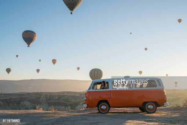 hot air balloons flying over valley in the morning. cappadocia. turkey - volkswagen stock pictures, royalty-free photos & images
