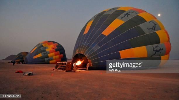 Hot air balloons getting ready to start a flight over the Namib Desert. Sossusvlei area. Sesriem. Namibia.