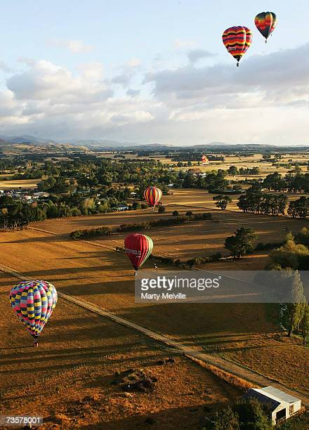 Hot Air Balloons glide across the Wiararapa Plains as part of the mass ascension during the Wairarapa International Hot Air Balloon Festival at...