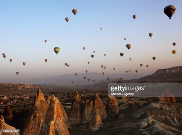 Hot air balloons glide in the sky during a trip over historical Cappadocia region in Nevsehir Turkey on February 7 2018 In the flying season for hot...