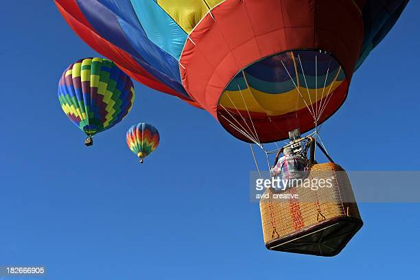 hot air balloons going up - balloon ride stock pictures, royalty-free photos & images