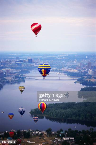 hot air balloons in air over gatineau during festival - gatineau stock pictures, royalty-free photos & images