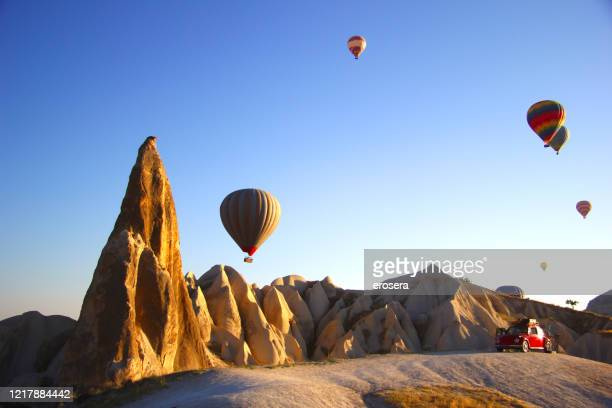 hot air balloons in cappadocia - rock hoodoo stock pictures, royalty-free photos & images