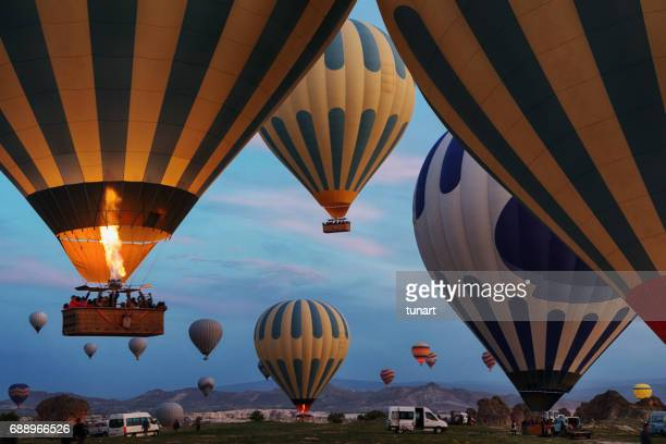 hot air balloons in cappadocia - hot air balloon stock pictures, royalty-free photos & images