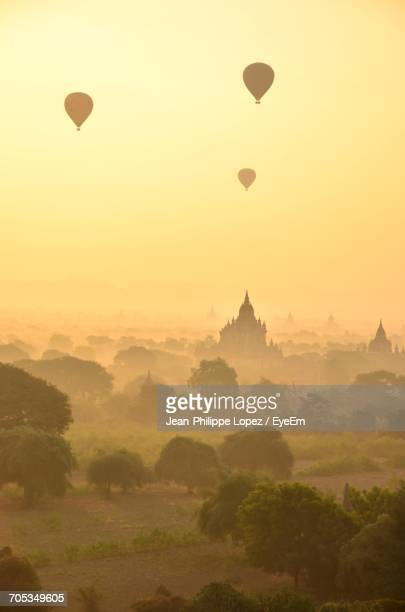 Hot Air Balloons In Sky At Sunset