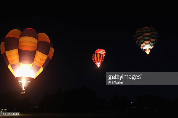 Hot air balloons leave from Innes Common at dawn on the second day of the Balloons Over Waikato Hot Air Balloon Festival on March 31 2011 in Hamilton...