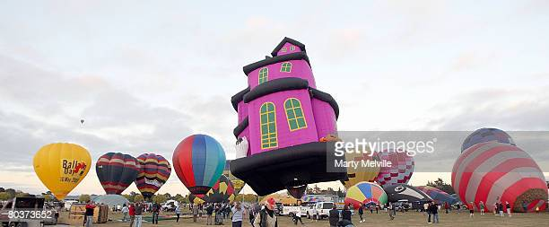 Hot air balloons lift off on the first day during the Wairarapa Hot Air Balloon Festival at the Carterton Show Grounds March 26 2008 in Carterton New...