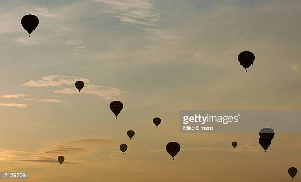 Hot air balloons make a mass ascension during the Inventing Flight celebration at the United States Air Force Museum July 6 2003 in Dayton Ohio The...