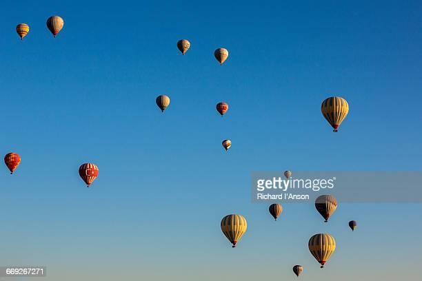 Hot air balloons over Cappadocia at sunrise