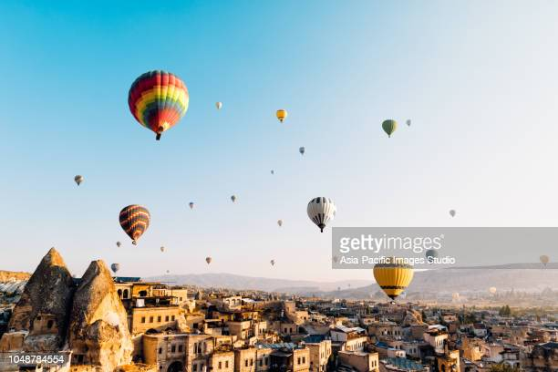 hot air balloons over cappadocia at sunrise,turkey - country geographic area stock pictures, royalty-free photos & images