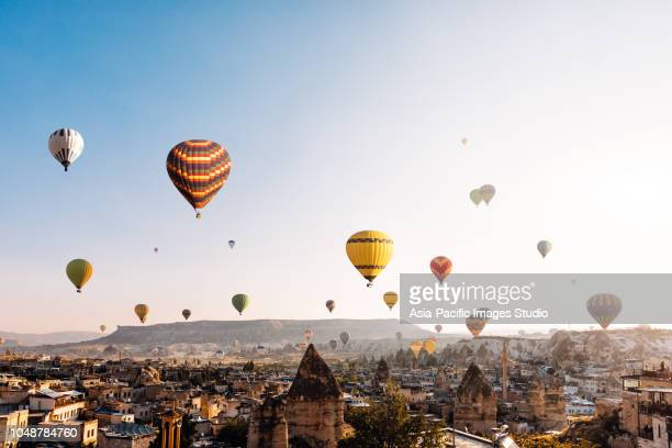 hot air balloons over cappadocia at sunrise,turkey - cappadocia stock pictures, royalty-free photos & images