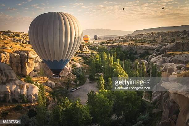hot air balloons over cappadocia, turkey - cappadocia stock pictures, royalty-free photos & images