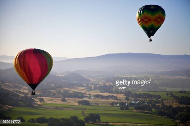 hot air balloons over green landscape, napa valley, california, usa - napa valley stock pictures, royalty-free photos & images