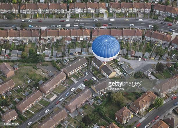 Hot air balloons pass over the Ashton Court Estate during the Bristol International Balloon Fiesta on 15 August 1990 in Bristol United Kingdom