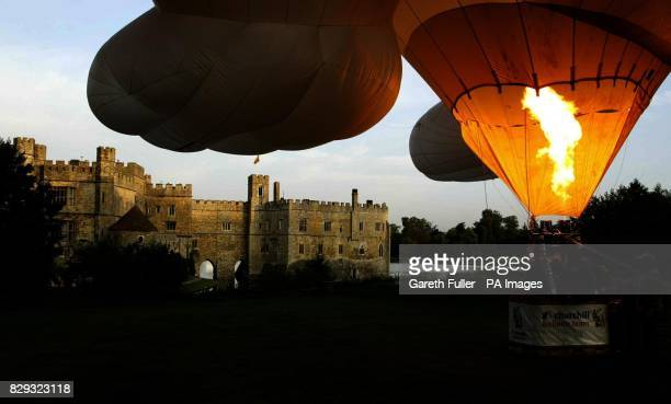Hot air balloons prepare to take to the skies above Leeds Castle in Kent as the castle prepares to host its annual Hot Air Balloon and Vintage Car...