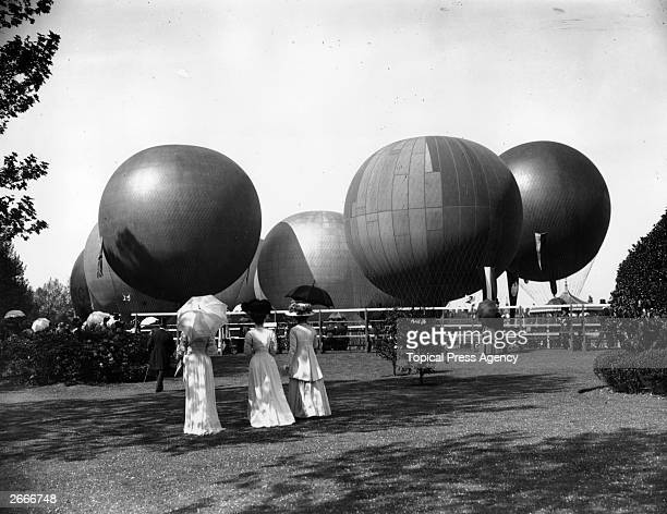 Hot air balloons prepared for a race at Hurlingham sports ground near London
