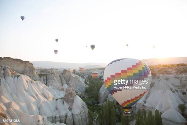 hot air balloons rise above desert landscape - mb media stock pictures, royalty-free photos & images