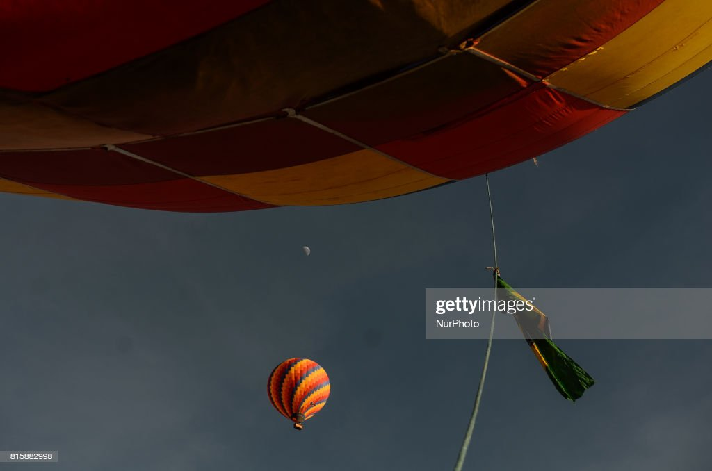 Hot air balloons rise into the sky at sunrise in Sao Lourenco, Minas Gerais, Brazil on July 16, 2017. Some hot-air balloons take off at sun rise to fly tourists over every sunday, Sao Lourenco, Brazil on July 16, 2017.
