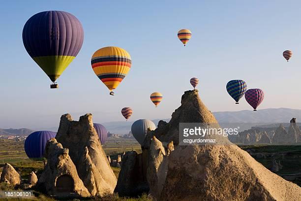 Hot air balloons rise over Cappadocia, Turkey.