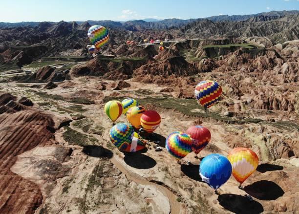 CHN: Hot Air Balloons Rise Over Danxian Landform In Zhangye