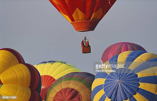 Hot air balloons rise to the sky at the Lorraine Mondial Air Balloon festival in July 1991 in Chambley near Metz France