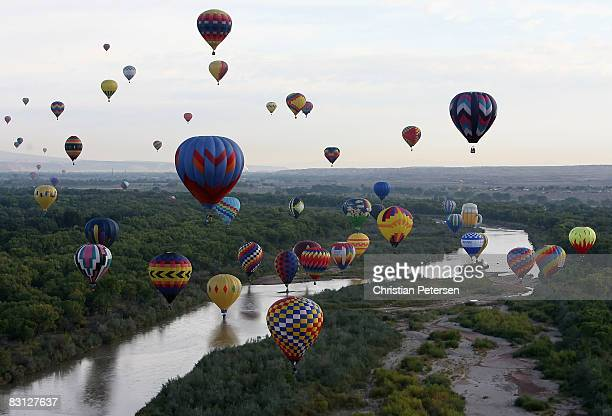 Hot air balloons soar over the Rio Grande during the Albuquerque International Balloon Fiesta on October 4 2008 in Albuquerque New Mexico This year...