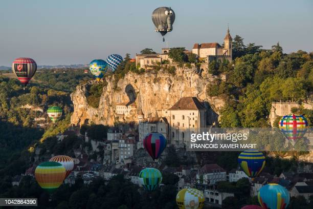 "Hot air balloons take off above the tourist site of Rocamadour, southwestern France, on September 29 during the ""33rd Montgolfiades"", which brought..."