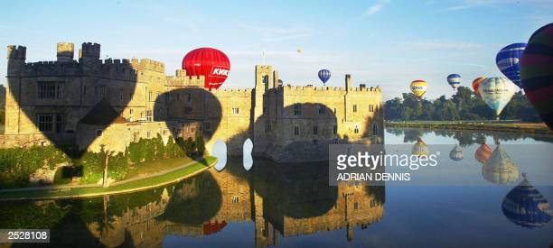 Hot air balloons take off at Leeds Castle near Maidstone in Kent 14 September 2003 The Castle was hosting the balloon and vintage car weekend which...