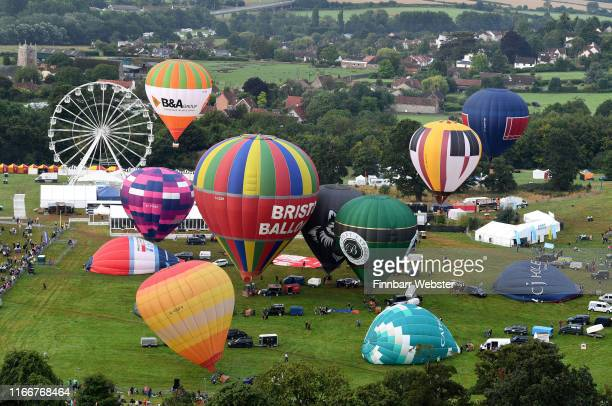Hot air balloons take to the skies as they participate in the mass ascent at sunrise on the first day of the Bristol International Balloon Fiestaon...