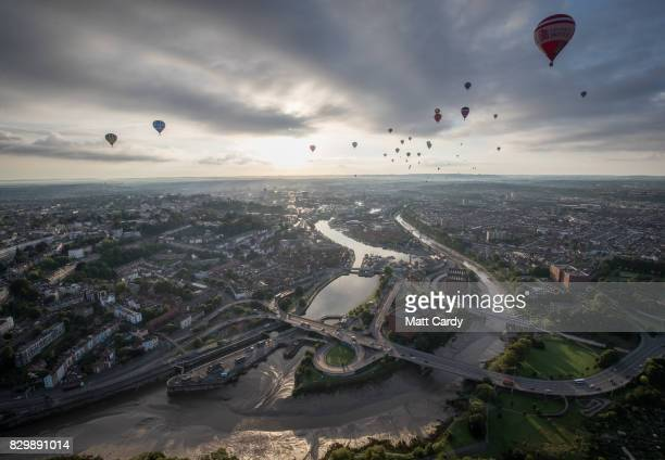 Hot air balloons take to the skies as they participate in the mass assent at sunrise on the second day of the Bristol International Balloon Fiesta on...