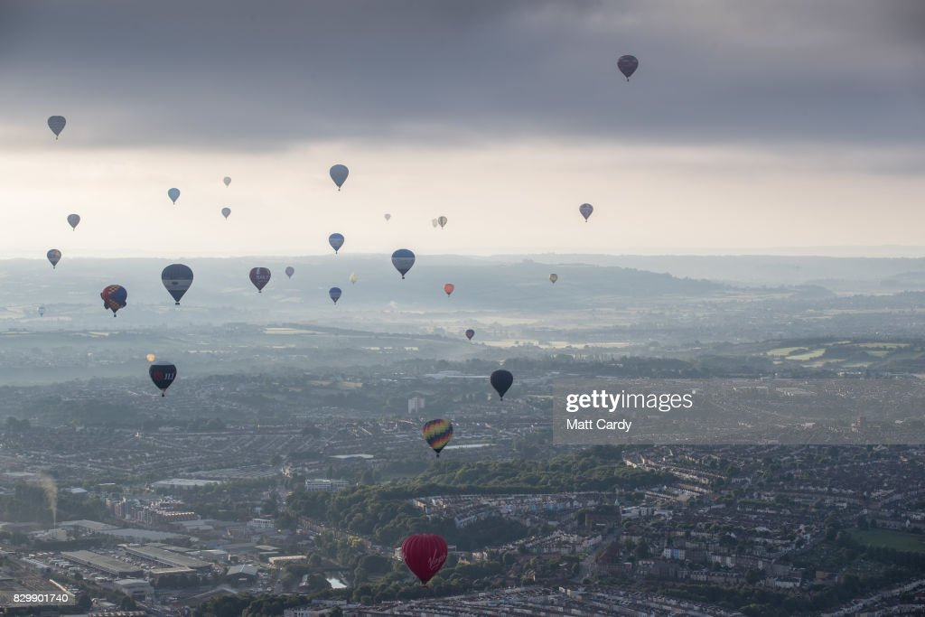 Hot air balloons take to the skies as they participate in the mass assent at sunrise on the second day of the Bristol International Balloon Fiesta on August 11, 2017 in Bristol, England. More than 130 balloons have gathered for the four day event, now in its 39th year and now one of Europe's largest annual hot air balloon events, being hosted in the city that is seen by many as the home of modern ballooning.