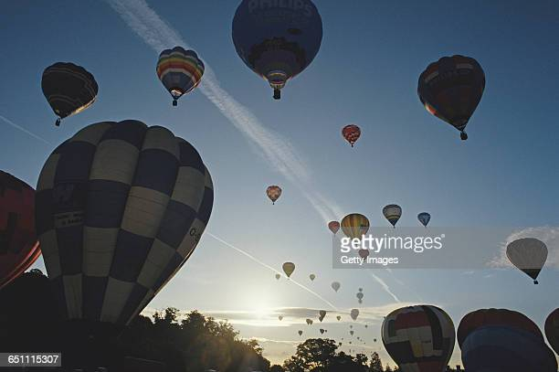 128 hot air balloons take to the sky in the then world record balloon lift at The Bristol International Balloon Fiesta on 15 August 1987 at Ashton...