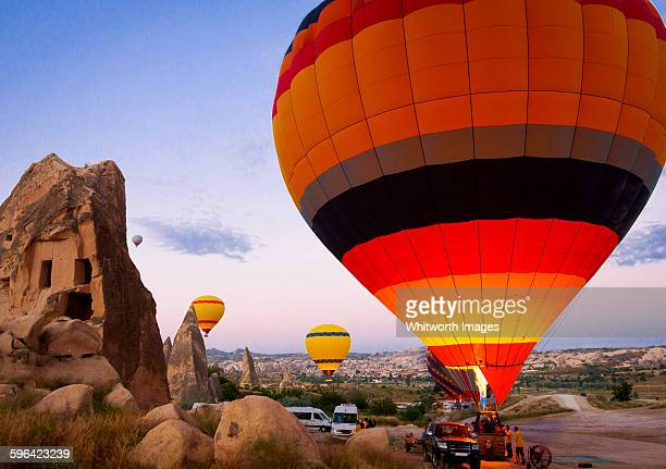 hot air balloons taking off at dawn - rock hoodoo stock pictures, royalty-free photos & images