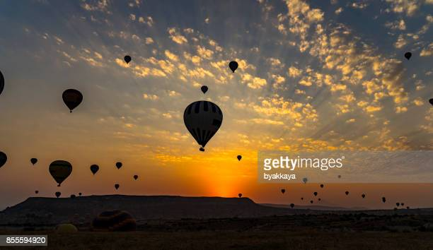 hot air balloons to fly over cappadocia - hot air balloon stock pictures, royalty-free photos & images