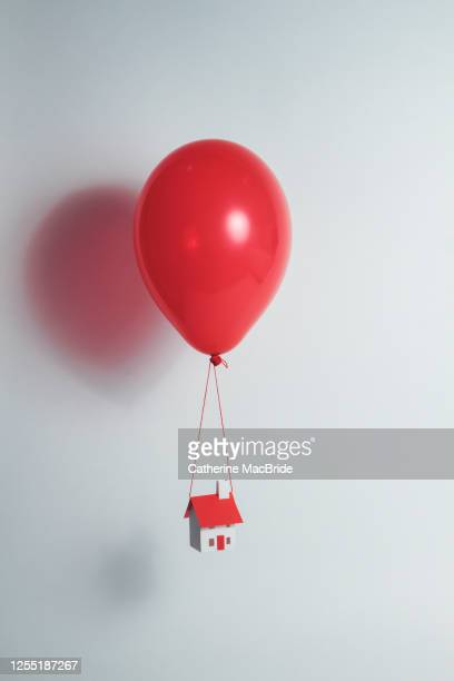 hot air paper house - catherine macbride stock pictures, royalty-free photos & images