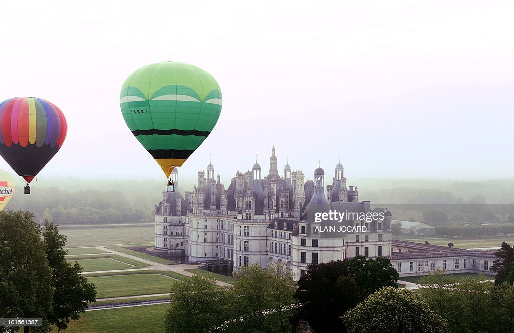 Hot air-balloons fly above the French Renaissance Chambord castle on May 15, 2010 in Chambord. Hot air-ballons drifted from May 14 to 16, 2010 in the Val de Loire skies during the fourth edition of the Montgolfiades de Loire 2010 event.