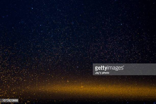 hot and cold defocused lights - gold colored stock photos and pictures