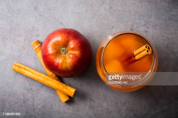 hot apple cider with cinnamon sticks, top view - cider stock pictures, royalty-free photos & images