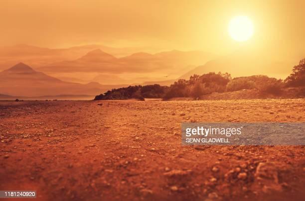 hot arid climate landscape - woestijn stockfoto's en -beelden
