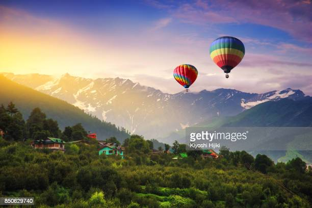 hot balloon air fly over manali town, india - kashmir freedom movement stock pictures, royalty-free photos & images