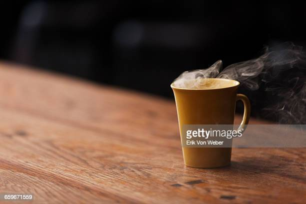 hot beverage on a wood cafe table