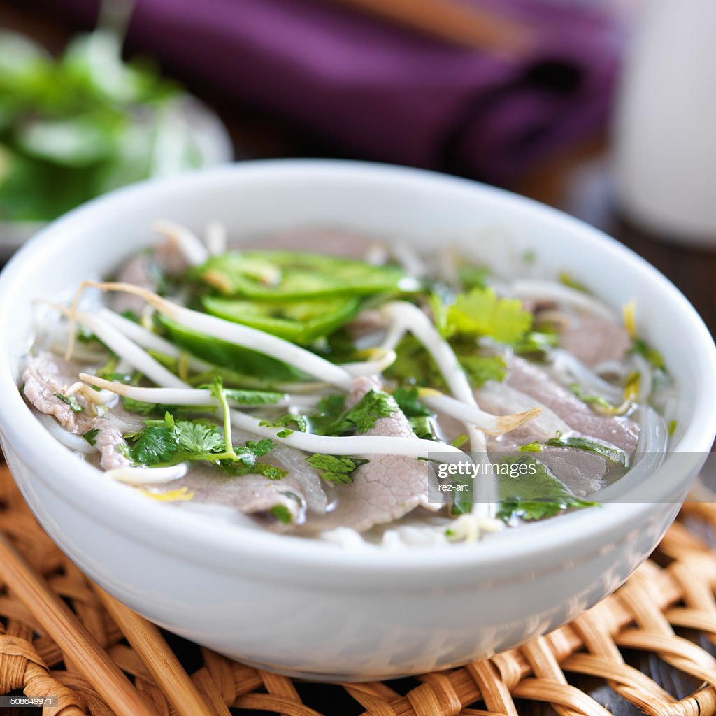 hot bowl of pho with beef and rice noodles : Stock Photo