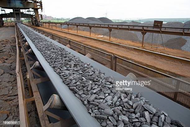 Hot briquetted iron moves along a conveyor belt at the Lebedinsky GOK iron ore mining and processing plant operated by Metalloinvest Holding Co in...