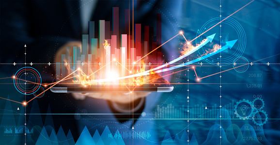 Hot business growth. Businessman using tablet analyzing sales data and economic growth graph chart. Business strategy, financial and banking. Digital marketing. 1165051903